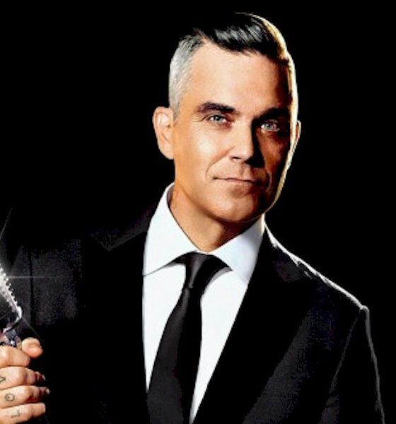 Robbie Williams é diagnosticado com coronavírus durante férias no Caribe